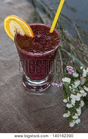 Fresh fruit smoothie from blueberry banana and orange juice