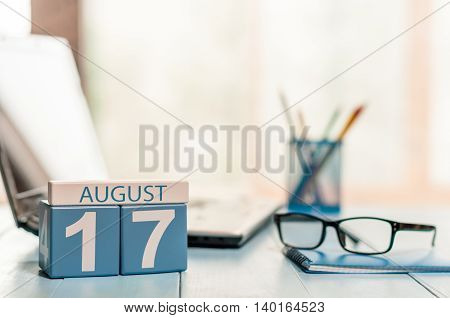August 17th. Day 17 of month, wooden color calendar on outsource business background. Summer time. Empty space for text.