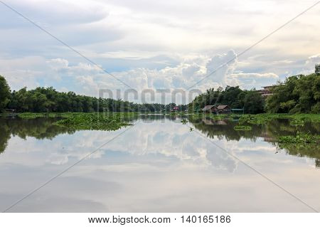 White cloud reflected in the river like a mirror