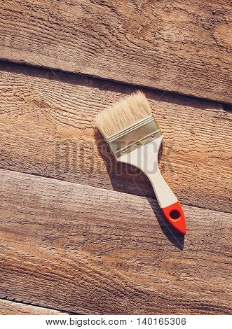 Paint Brush On Wooden Table. House Renovation.