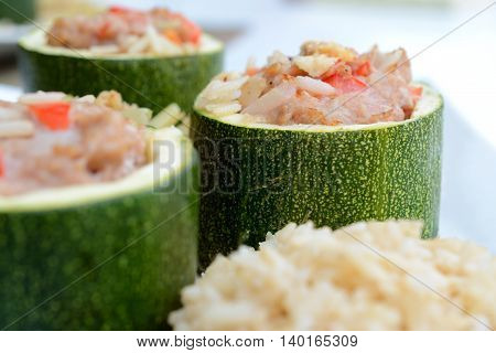 Courgette stuffed with minced meat rice and french bean on white plate. Shallow depth of field.