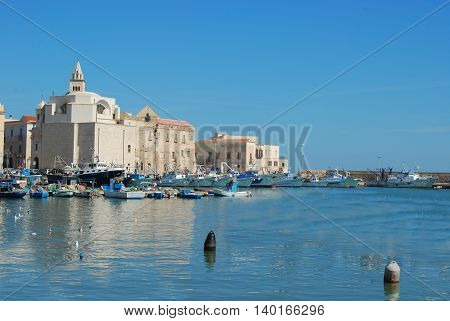 Boats and fishing boats moored in the Port of Trani in Apulia - Italy