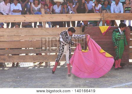 Magdalena Cajamarca Peru - July 23 2016: Matador practices moves with cape in Magdalena Cajamarca Peru on July 23 2016