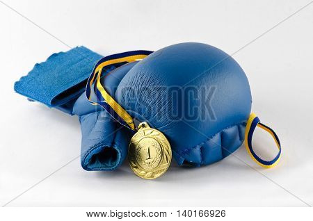 gloves for martial arts and a gold medal