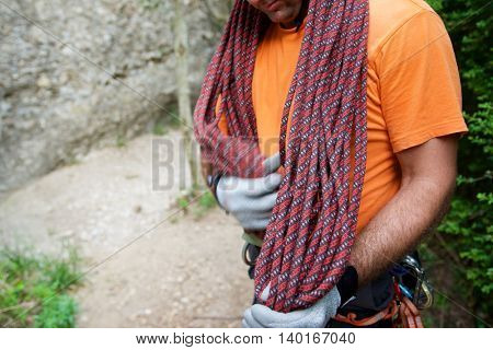 Climber with rope folded in Vadiello, Guara Mountains, Huesca, Aragon, Spain.