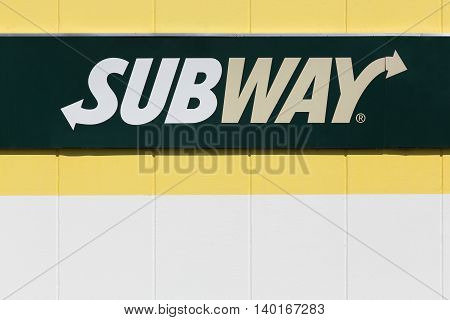 Lozanne, France - July 7, 2016: Subway logo on a facade. Subway is an American fast food restaurant franchise that primarily sells submarine sandwiches and salads