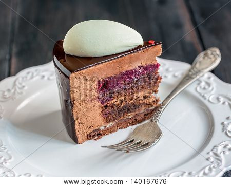 Piece Of Modern Mousse Cake With Chocolate Glaze.