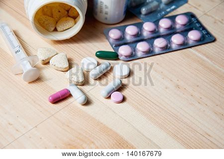 Syringe and medications pills drug, copy space