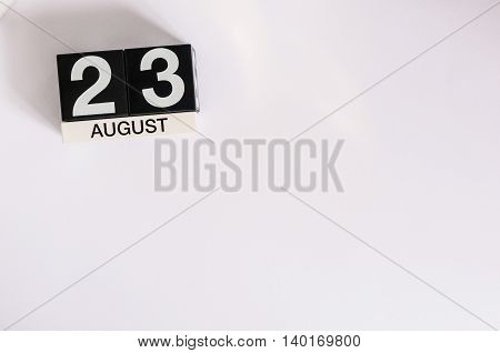 August 23rd. Image of august 23 wooden color calendar on blue background. Summer day. Empty space for text.