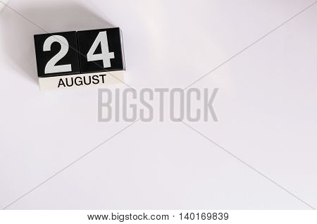 August 24th. Image of august 24 wooden color calendar on blue background. Summer day. Empty space for text.