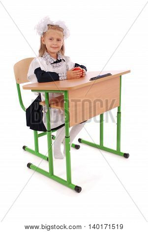 Little Schoolgirl sitting at a desk white background with soft shadow