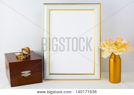 Frame mockup with wooden box. Portrait white frame mockup. Empty white frame mockup for presentation artwork design.