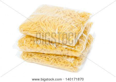 three packets of pasta on a white background
