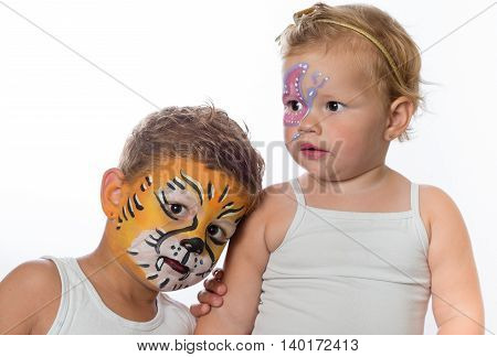 lovely boy and child brother and sister with face paintings on