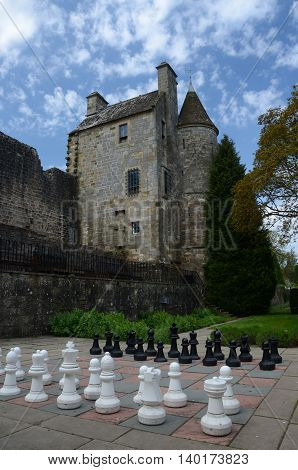 An outdoor garden chess game in the grounds of Falkland palace