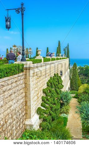 HAIFA ISRAEL - FEBRUARY 20 2016: The numerous tourists visit Bahai Gardens and Shrine enjoying the perfect landsaping and nice views on February 20 in Haifa.