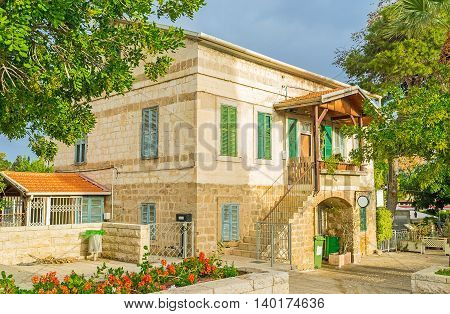The typic house of the German Colony surrounded by trees and flower beds Haifa Israel.
