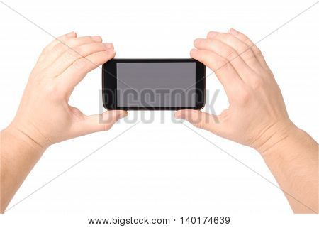 Man hand holding a smartphone with blank screen isolated on white