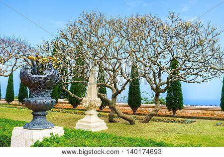 The vase with gilt metal flowers in Bahai Gardens Haifa Israel.