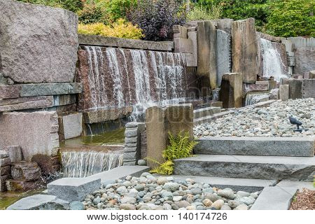 View of a fountain made up of rock walls and waterfalls.