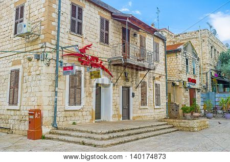 HAIFA ISRAEL - FEBRUARY 20 2016: The old stone cottages of German Colony are the perfect places for hotels cafes taverns souvenir stores and art galleries on February 20 in Haifa.