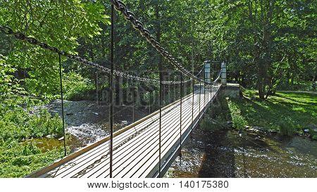 Old bridge throw small river in Estonia