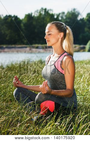 Young Woman Makes Yoga Exercises
