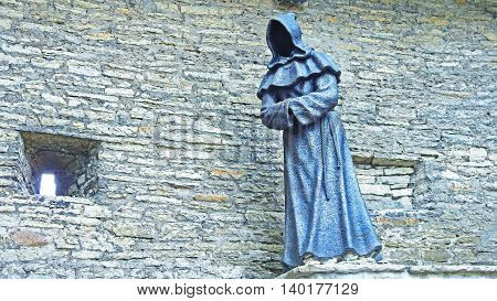 Metal statue of monk in Tallinn old city center