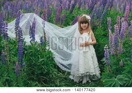 photo of little beautiful girl with bride dress