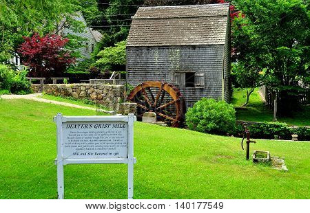 Sandwich Massachusetts- July 13 2015: 1637 Dexter's Grist Mill and water wheel is a fully functional facility that continues to produce corn meal which is sold on site