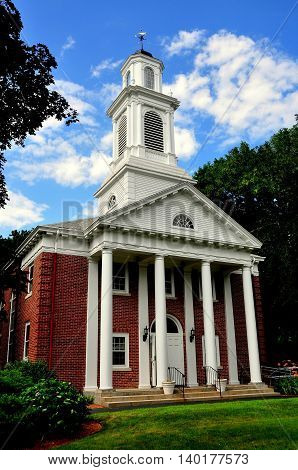 Weston Massachusetts - July 14 2013: Colonial-style First Baptist Church with columned portico and steeple topped with a cupola