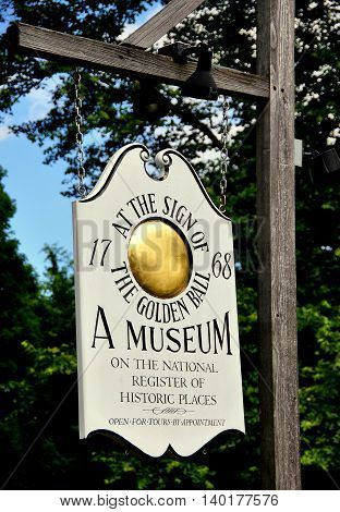 Weston Massachusetts - July 14 2013: Sign at the historic 1768 Golden Ball Tavern now fully restored and operated as a colonial-era museum
