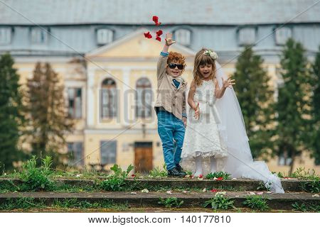 photo of two funny little bride and groom