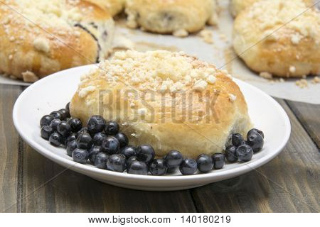 Homemade, delicious  buns with berries and crumble