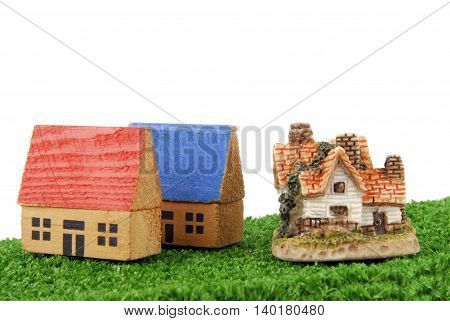 closeup of the concept of miniature houses on grass
