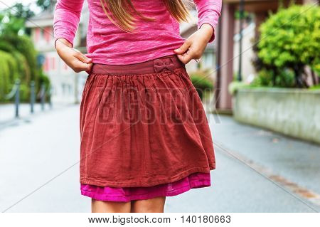 Close up of little girl's skirt, outdoors