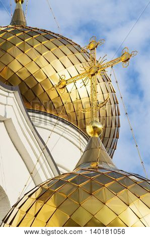 An beautiful view of the Cathedral Of The Assumption in Yaroslavl with golden domes and part of walls. It originally built out of stone in the 12th century, was reconstructed  in the 21th century