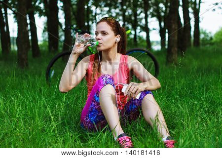 Sports Woman With A Bottle Of Water And A Phone