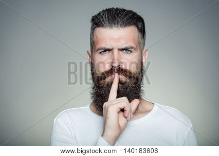 Bearded Man With Hush Gesture