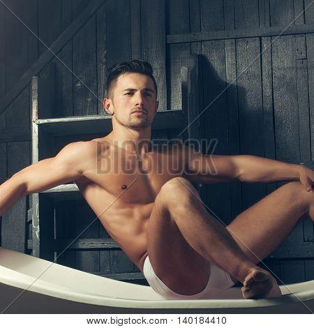 Muscular Man On Bathtub