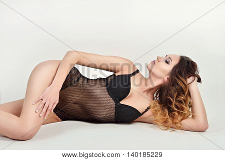 Beautiful Sexy Lady In Elegant Bodysuit Isolated On A White Background. Fashion Portrait Of Model In