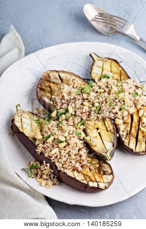 Roasted eggplant with quinoa salad and pine nuts vegan dish
