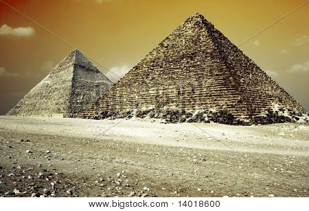 Grate pyramids in Giza valley with red sky