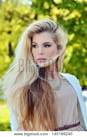 Fashionable Portrait Of Lady With Long Hair In City. Image Of Blonde Model On Bright Background. You