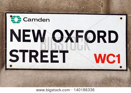 A sign on a street wall for New Oxford Street in Central London
