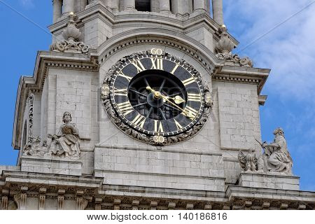 Closeup of St. Paul's Cathedral clock and clock tower