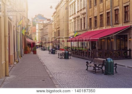 LVIV UKRAINE - MAY 8 2016: Morning in the center of Lviv. Empty old-style streets full of cafes and restaurants Ukraine