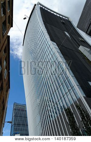 LONDON UK - JULY 1 2014: The City's new giant office tower under construction on 20 Fenchurch Street generally known as the 'Walkie Talkie' because of its shape.