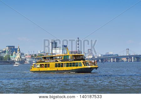 KIEV UKRAINE - JULY 24 2016: Closeup of a yacht with people on board sailing at speed in Dnieper river Kiev Ukraine