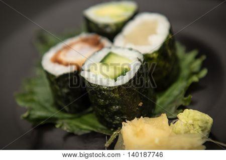 Sushi maki rolls with salmon avocado and prawns